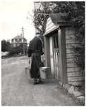 Image - Monk carrying buckets
